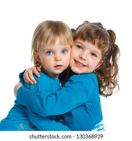 Closeup portrait of two happy cute sisters. Isolated white background