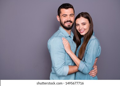 Close-up portrait of two her she his he nice attractive charming lovely careful sweet tender lovable cheerful cheery person embracing isolated over gray violet purple pastel background