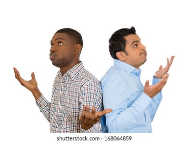 Closeup portrait of two men back to back putting hands in air looking up in frustration, isolated on white background. Negative human emotion facial expression feelings. Miscommunication conflict