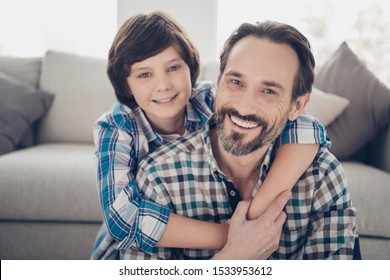 Close-up portrait of two nice attractive lovely tender cheerful cheery guys dad daddy and pre-teen son cuddling hugging at light white modern style interior house living-room indoors