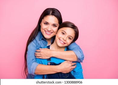 Close-up portrait of two nice cute pretty trendy stylish lovely attractive cheerful positive dreamy girls care trust feelings new family life mood isolated over pink pastel background