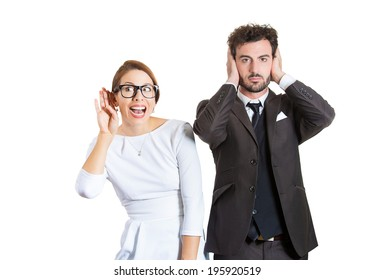 Closeup portrait two workers, couple, business man corporate employee, nosy woman listening to gossip, guy covering ears ignoring, hear no evil isolated white background. Life perception differences