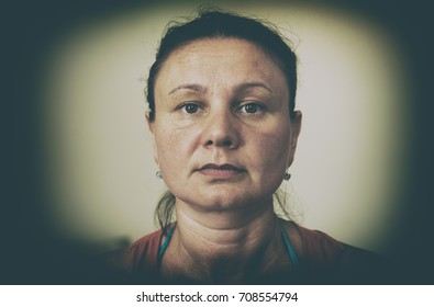 Close-up portrait of an ugly unhappy adult woman