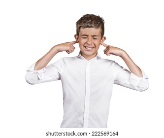 Closeup portrait unhappy annoyed young man plugging closing ears with fingers disgusted ignoring something not wanting to hear someone side story isolated white background. Human emotion body language