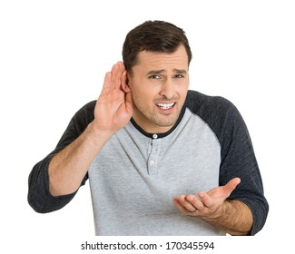 Closeup portrait of unhappy hard of hearing man placing hand on ear asking someone to speak up or listening to bad news, isolated on white background. Negative emotion facial expression feelings.