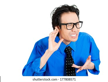 Closeup portrait of unhappy hard of hearing sad man placing hand on ear asking someone to speak up, listening to bad news, isolated on white background. Negative emotion, facial expressions, feelings.
