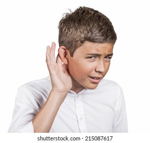 Closeup portrait unhappy hard of hearing young man placing hand on ear asking someone speak up, listening bad news isolated white background. Negative emotion, facial expression feeling body language