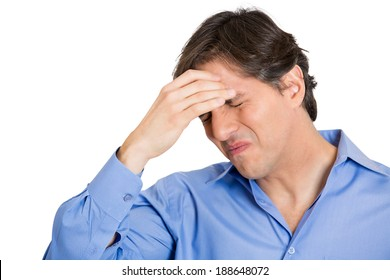 Closeup portrait, unhappy, sad, thoughtful, young business man thinking deeply, bothered by mistakes, hands on head, having headache isolated white background. Negative emotion facial expressions