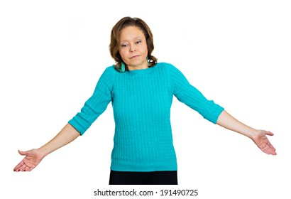 Closeup portrait unhappy, senior mature woman, teacher, worker shrugging shoulders, arms spread in air, doesn't have answer, know, so what, regretful isolated white background. Negative human emotions