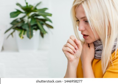 Closeup portrait of unhealthy young European blonde woman coughing a lot, suffering with cough, has a chest pain/ Sick desperate female has flu/Cold, sickness, bronchitis concept/Fit of coughing