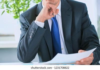 Closeup portrait of unrecognizable businessman in black formal s