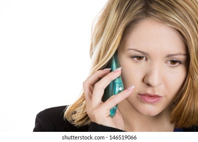 Close-up portrait of an upset, sad, depressed and worried blonde woman talking on the phone, isolated on a white background