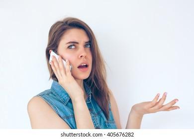 Closeup portrait upset, unhappy, serious woman talking on phone