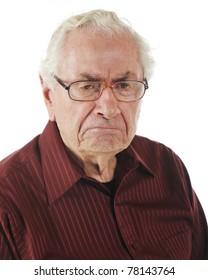 Closeup portrait of a very grumpy senior man.