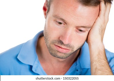 Closeup portrait of a very sad, depressed, alone, disappointed man resting his face on hand, side profile isolated on white background