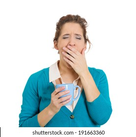 Closeup portrait very tired, falling asleep woman, employee holding cup coffee, struggling not crash, stay awake, keeping eyes opened isolated white background. Human face expression, feeling reaction