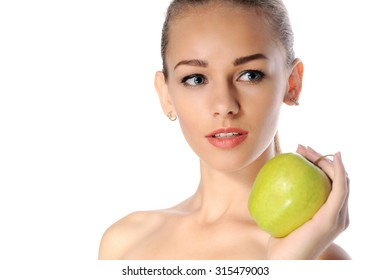 Close-up portrait of a woman with an apple in her hand on isolated background