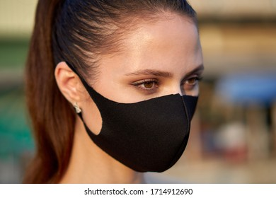 Closeup portrait of a woman in the black mask to protect herself from the Covid-19 coronavirus in Bangkok, Thailand.