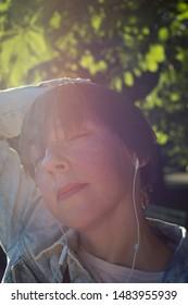 Closeup portrait of a woman in headphones
