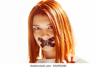 Closeup portrait of woman with taped mouth.