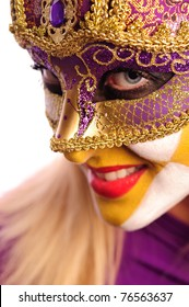 Close-up portrait of woman in violet mask, isolated on white