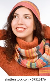 Close-up portrait of a woman wearing bright hat and scarf