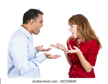 Closeup portrait, young angry couple, man, woman, screaming at each other, blaming for problem, isolated white background. Marriage difficulties concept, negative emotions, expressions, feelings