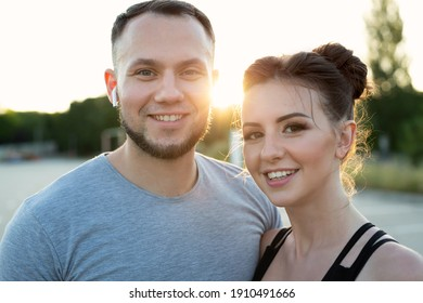 Close-up portrait of young athletes at sunset