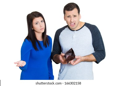 Closeup portrait of young attractive man woman couple showing empty wallet, being broke over the budget and poor, isolated on white background. Negative facial expression emotion feelings