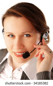 Closeup portrait of a young beautiful business woman with headset, isolated over white background