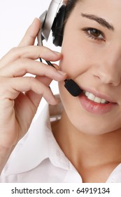 Close-up portrait of a young beautiful business woman using head phone