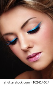 Close-up portrait of young beautiful girl with stylish make-up