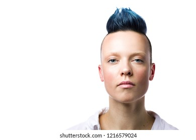Close-up portrait of young beautiful punk woman with blue hair. Isolated on white background with free space