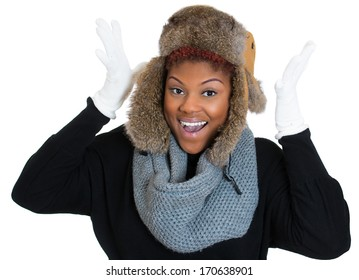 Closeup portrait of young beautiful smiling woman wearing winter gear, gray scarf, white gloves, fur ski cap, and black sweater, isolated on white background. Positive emotion facial expression