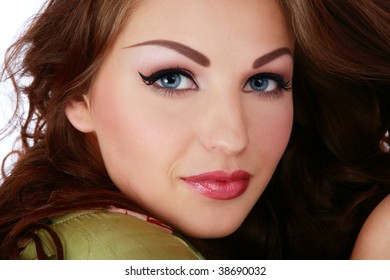 Close-up portrait of young beautiful smiling woman with stylish makeup
