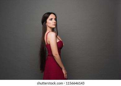 Closeup portrait of young beautiful woman with with beautiful long hair.  posing in studio. Portrait of trendy, cheerful, modern, stylish, woman in eyewear isolated on grey background.