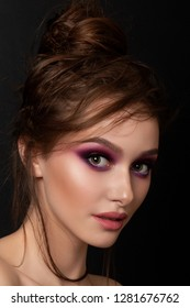 Closeup portrait of young beautiful woman with bright pink smokey eyes. Fashion makeup. Studio shot. Modern bright summer make up