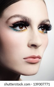 Close-up portrait of young beautiful woman with cat eye make-up and fancy false eyelashes