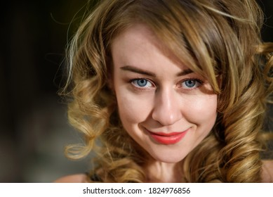 Closeup portrait of young beautiful woman looking at camera