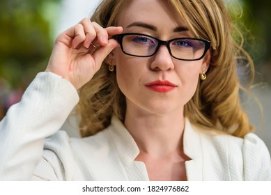 Closeup portrait of young beautiful woman with glasses