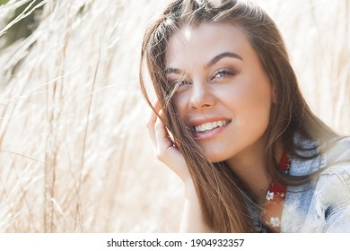 Closeup portrait of young beautiful woman outdoors. Attractive young female on neutral background.