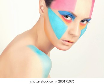 close-up portrait of young beautiful woman with paint on the face.Beauty make-up. Body art sexy girl