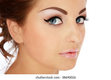 Close-up portrait of young beautiful woman with stylish makeup