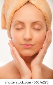 Closeup portrait of young beautiful woman after bath.