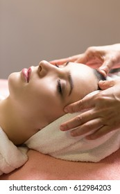close-up portrait of young beautiful woman in spa environment. closed eyes