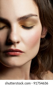 Close-up portrait of young beautiful woman with closed eyes with stylish make-up