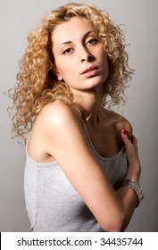 closeup portrait of young blond curly hair woman