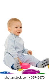 closeup portrait of the young boy playing with the educational toys isolated on a white background