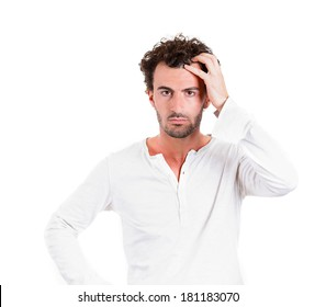 Closeup portrait young business man thinking trying to remember something, confused, looking for right answer isolated white background. Negative emotions, facial expressions. Short-term memory loss