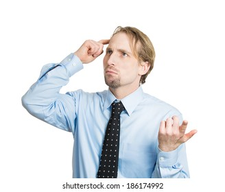 Closeup portrait young business man thinking, daydreaming, trying hard to remember something looking confused, isolated white background. Negative emotion facial expressions. Short-term memory loss